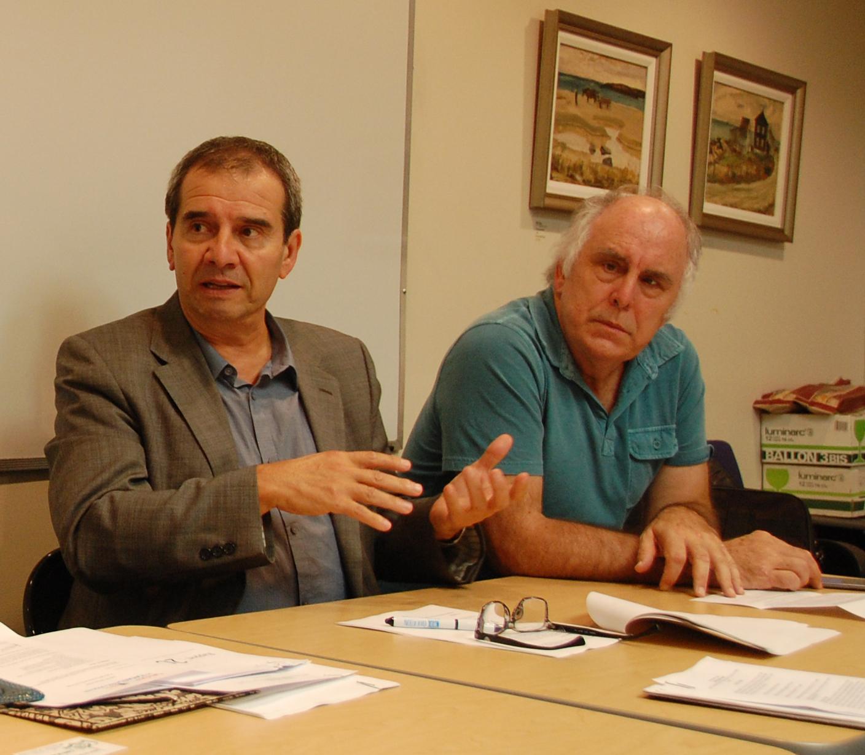 Le président Valéry Vlad et le directeur général Paul Savoie du Salon du livre de Toronto.